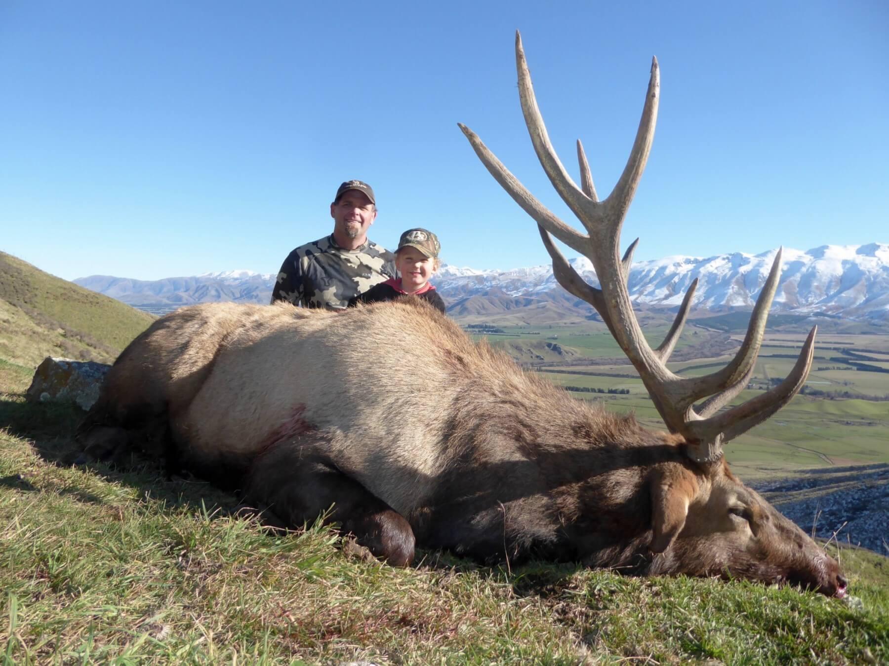 elk hunter with trophy elk and child