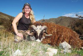 woman with arapawa ram trophy new zealand