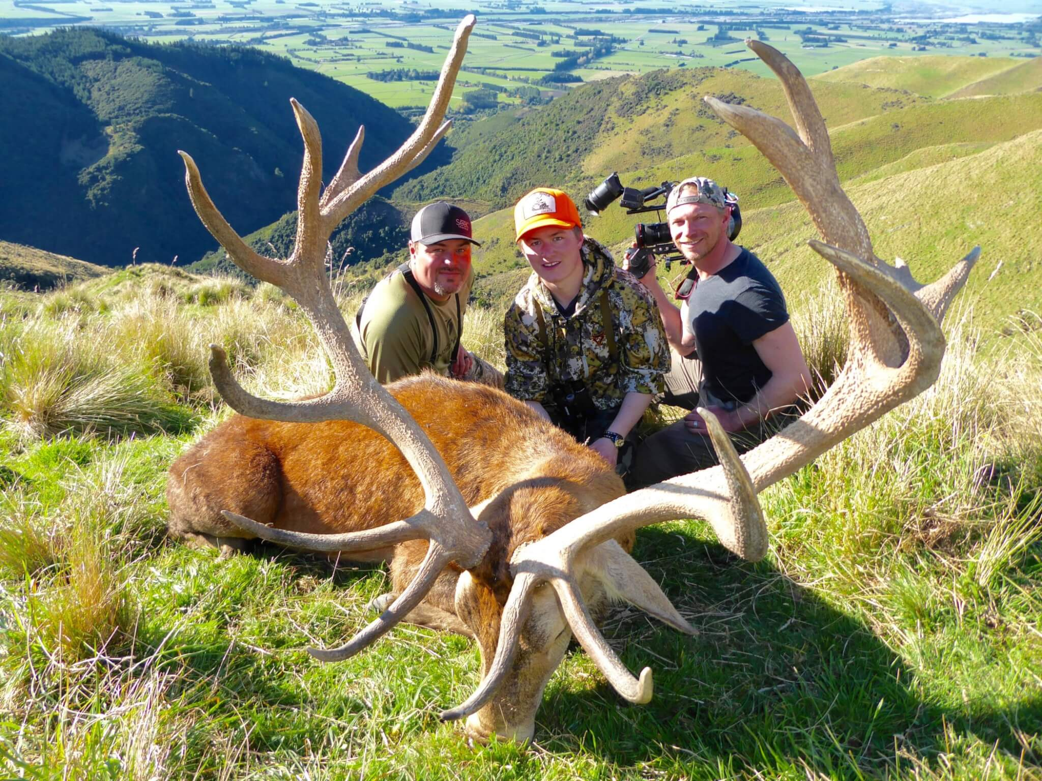 film crew with red stag trophy