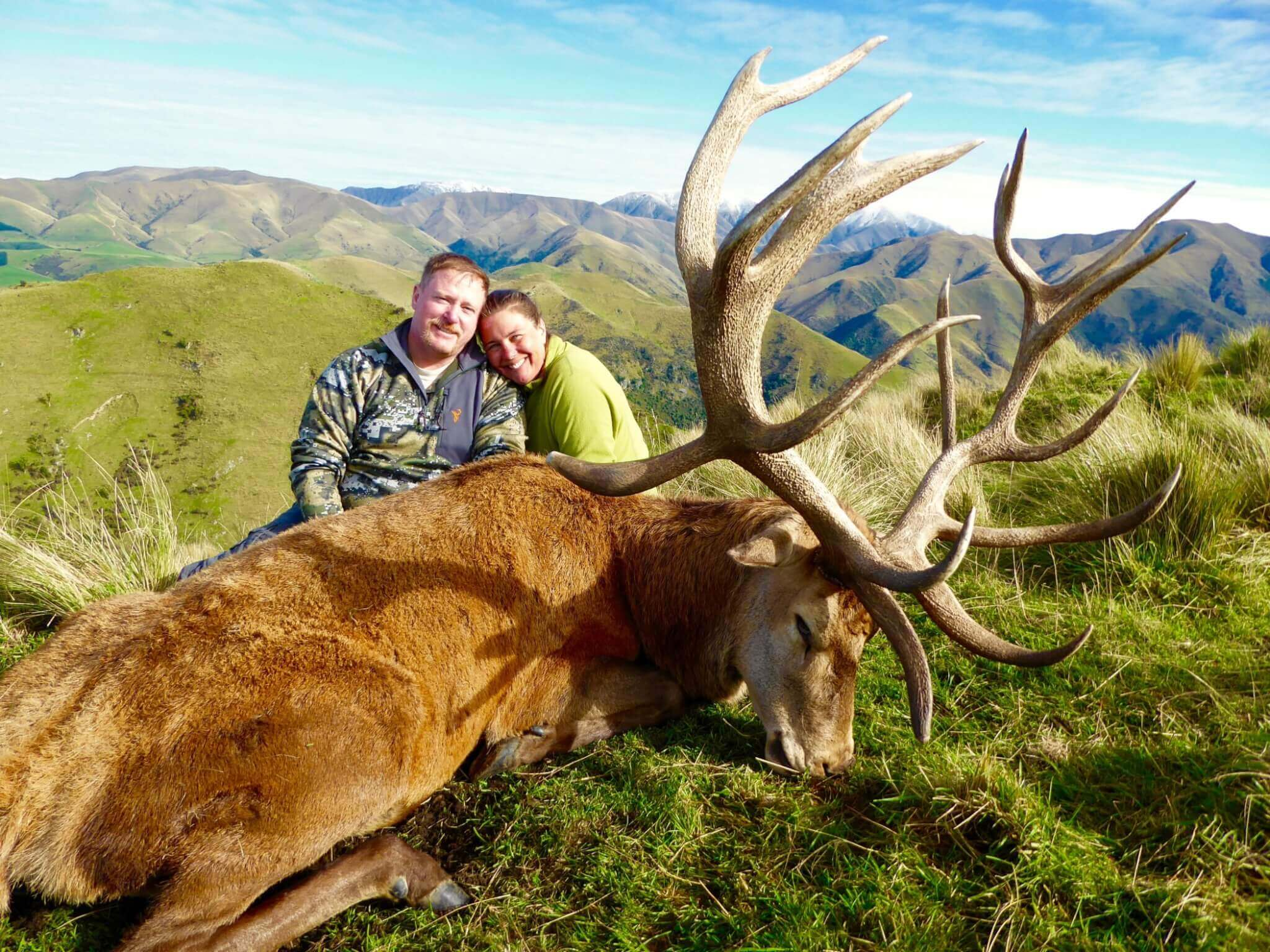 happy couple with red stag trophy