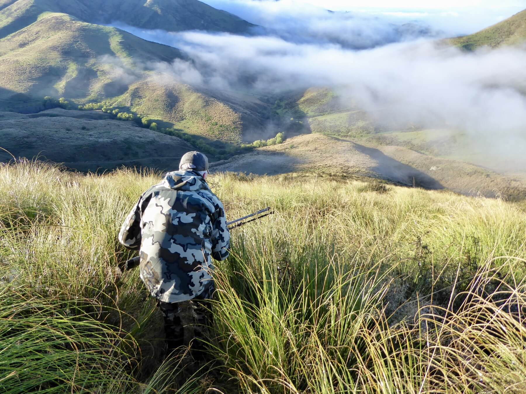 hunters Stalking Red Stag in New Zealand